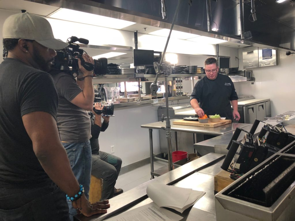 Chef cooking in kitchen at Topgolf Las Vegas